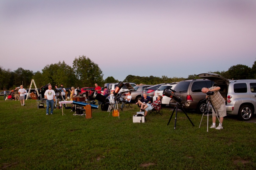 Photo: Astronomers setting up telescopes in early twilight. Photo by James Guilford