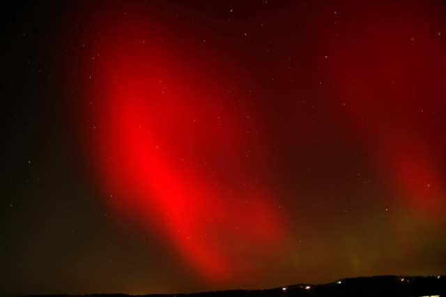 Photo: Brilliant red aurora over rural Ohio the night of October 24, 2011. By Joe Golias.
