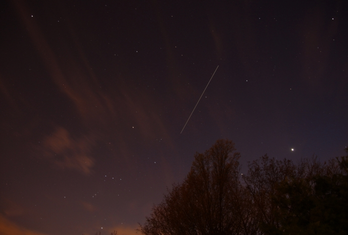 Photo: Long trail of the International Space Station in the evening sky. By Bruce Lane.
