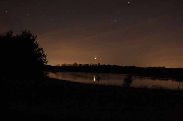 Photo: Planet Venus setting over calm waters. Photo by Jay Reynolds.