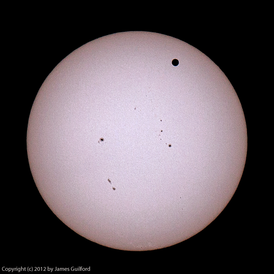 Photo: The Sun with silhouette of planet Venus in transit.