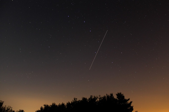 Photo: Arc of the International Space Station passing through the Big Dipper. Credit: Chris Christie.