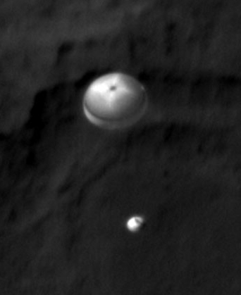 Photo: Tightly-cropped view of Curiosity descending towards a Mars landing.