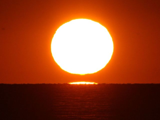 Photo: Sunset with possible green flash. Credit: Jay Reynolds