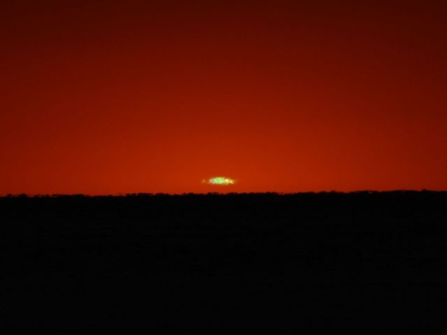 Photo: Green flash is visible just after sunset August 6, 2012. Credit: Jay Reynolds