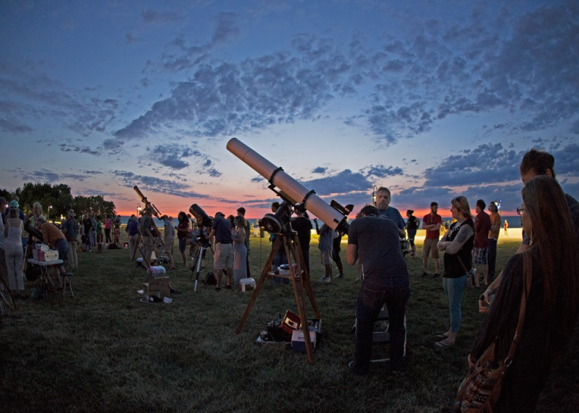 Photo: After sunset scopes pointed skyward and offered views of planets Jupiter, Mars, and Saturn. Photo by James Guilford.