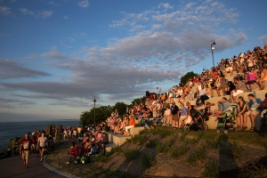 Photo: Celebration attendees cover the Lakewood Park Solstice Steps as they watch the Lake Erie Sunset. Photo by James Guilford.