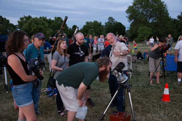 Photo: Jay Reynolds, gesturing as attendees view Jupiter, coordinated CAA's participation in the Celebration. Photo by James Guilford.