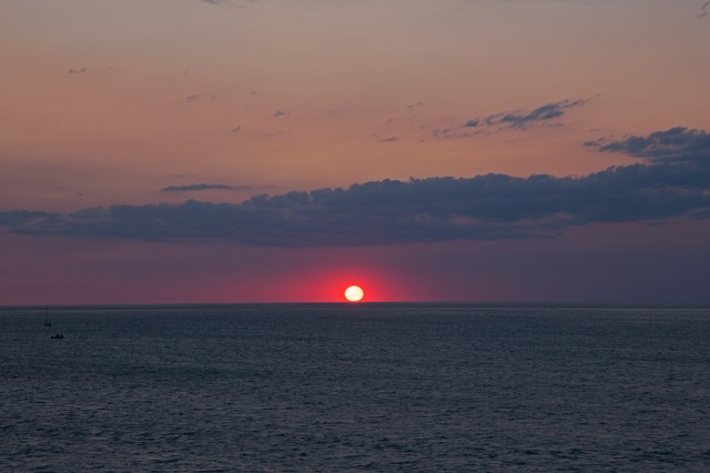 Photo: Oh yes, the sunset! The Celebration was blessed with a gorgeous Lake Erie sunset. The crowd broke into applause as the last bit of red-orange sun disappeared below the horizon! Photo by James Guilford.