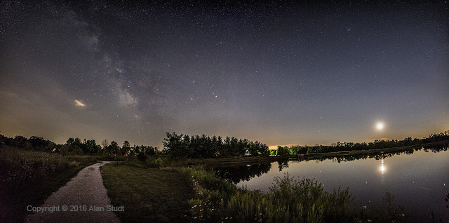 Photo: Looking South Along the Lake at Letha House Park, Milky Way Glowing Overhead, the Moon Sinking Low in the West. Photo by Alan Studt.