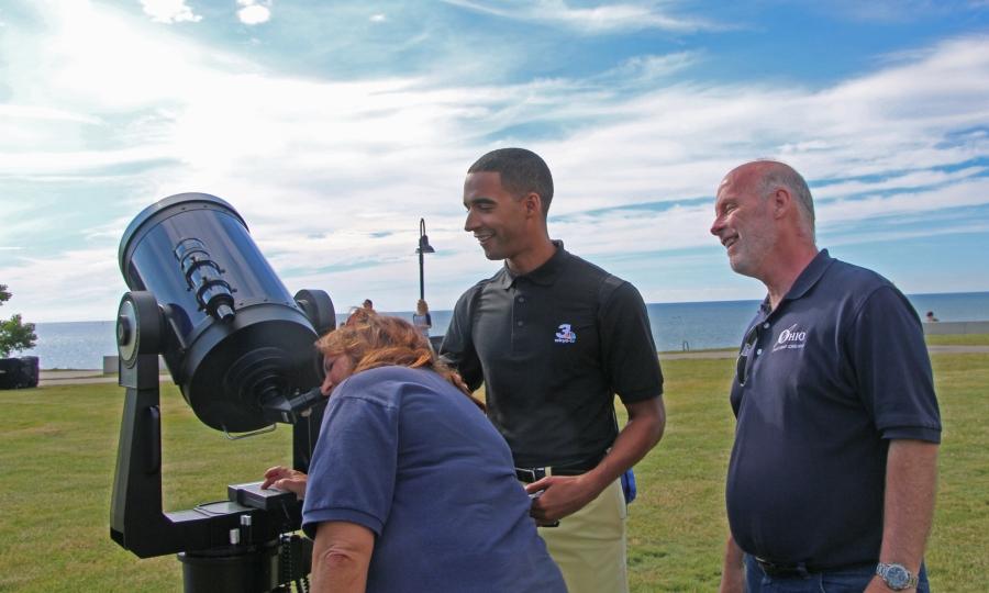 Photo: Suzie Dills, Michael Estime, Jay Reynolds Observe the Sun, by Carol Lee