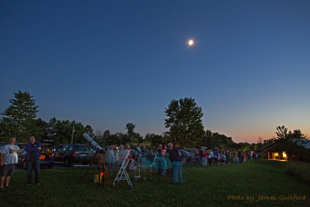 Photo: Group pauses to watch a passage of the International Space Station. Photo by James Guilford.