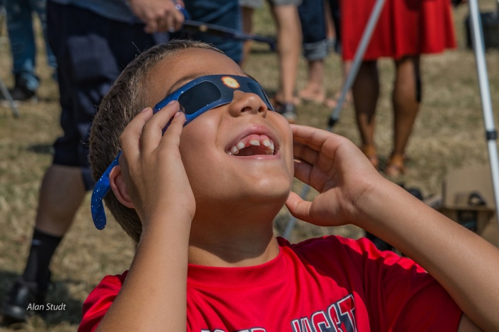 Photo: Boy wearing eclipse glasses. Credit: Alan Studt