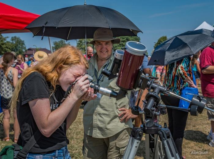 Photo: Using telescope whilst holding parasol. Credit: Alan Studt