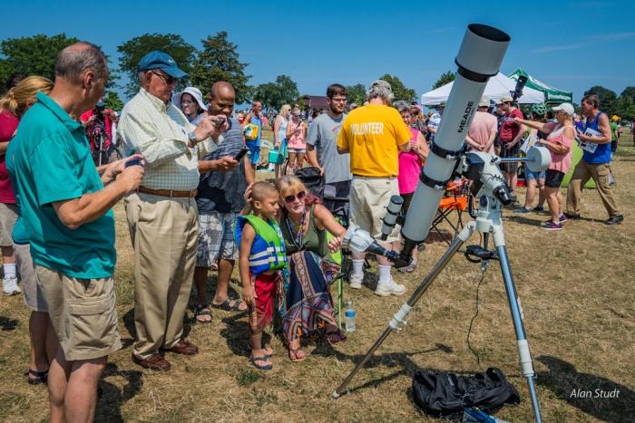 Photo: Group viewing eclipse via projection. Credit: Alan Studt