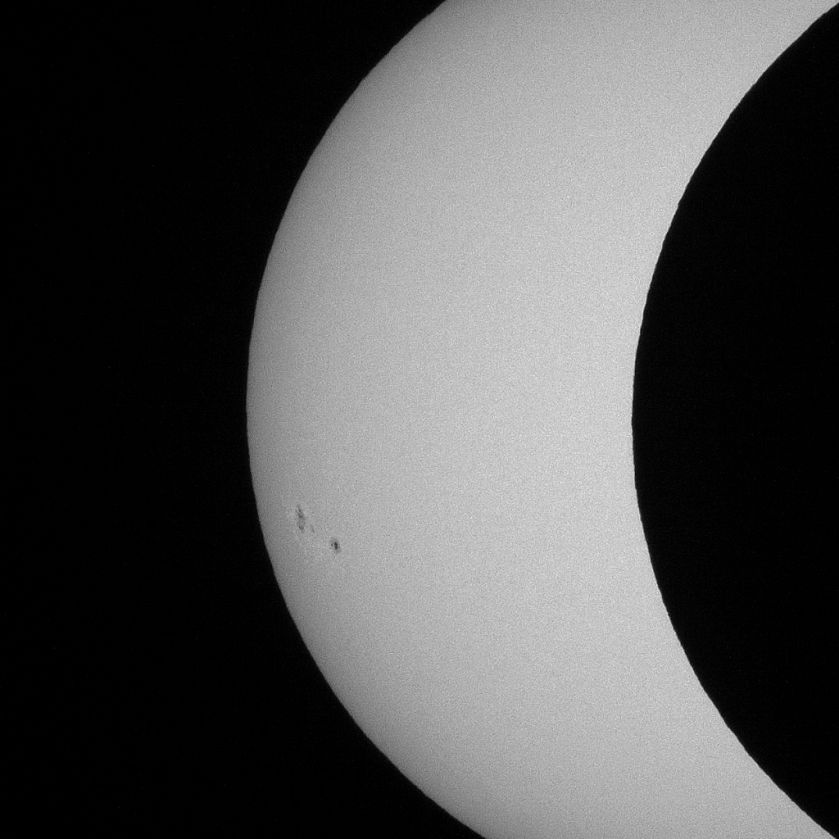 Photo: Edge of lunar disk against Sun. Photo by James Guilford.