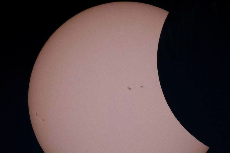 Photo: Partial Solar Eclipse. Credit: Bruce Lane.