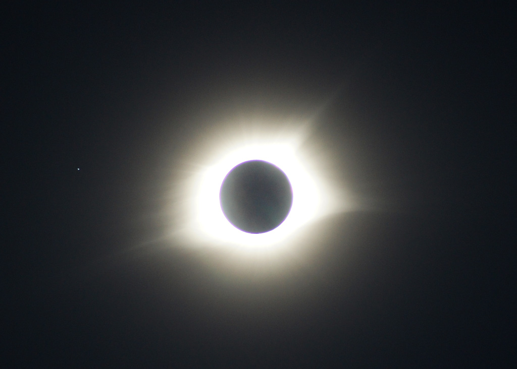Photo: Totality with Earth Shine - Handheld. Credit: Matt Franduto