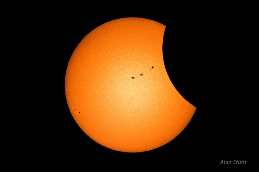Photo: Early eclipse with sunspots. Credit: Alan Studt