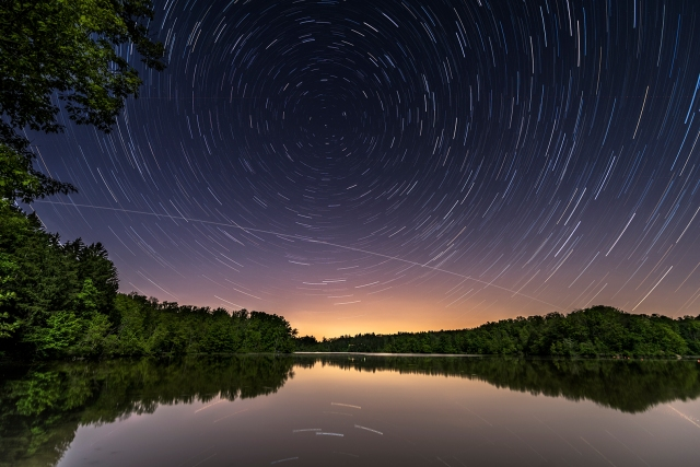 Photo: Star trails around Polaris are interrupted by a pass of the International Space Station. Photo by Alan Studt.