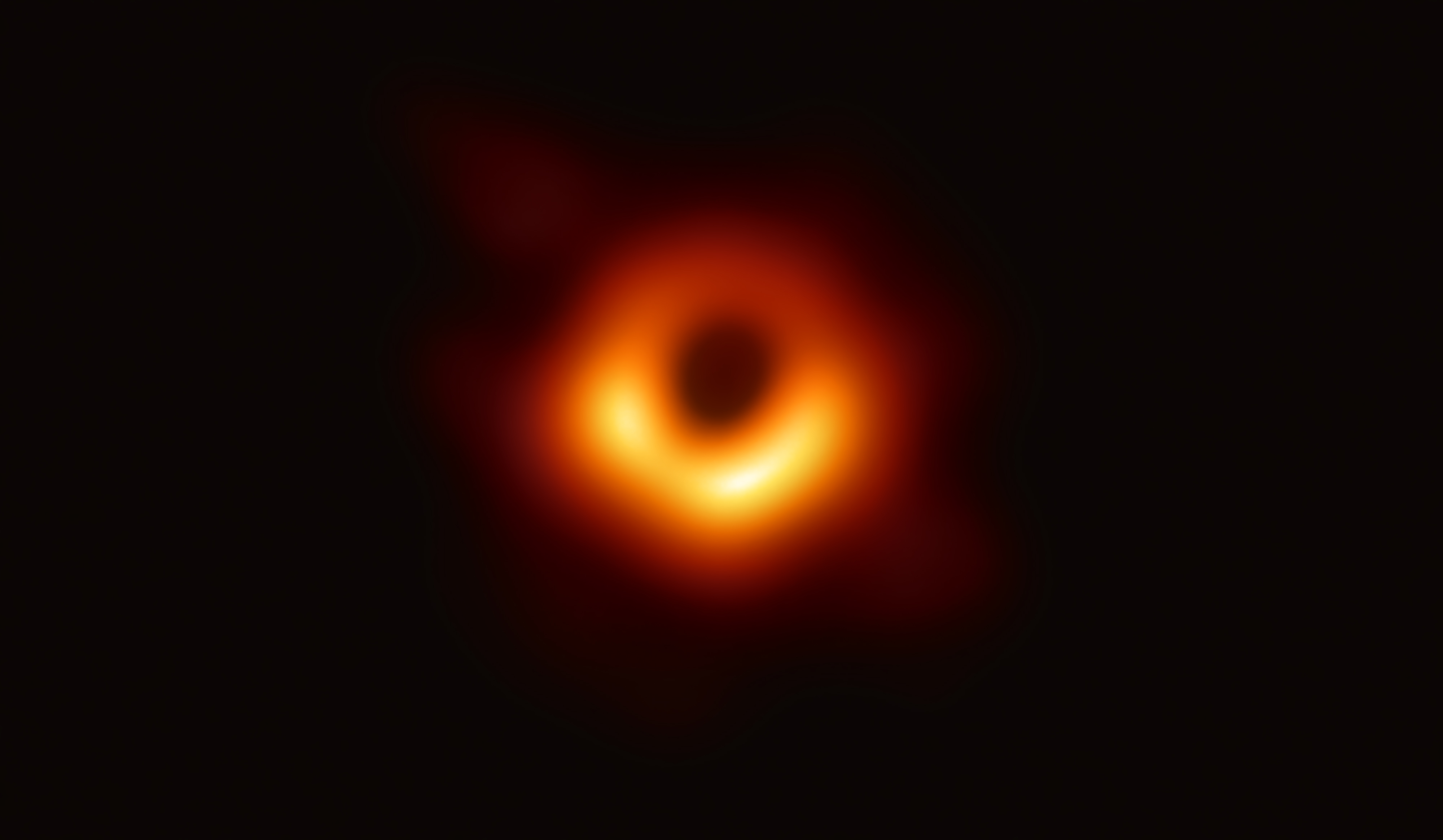 Photo: Using the Event Horizon Telescope, scientists obtained an image of the black hole at the center of galaxy M87, outlined by emission from hot gas swirling around it under the influence of strong gravity near its event horizon. Credit: Event Horizon Telescope collaboration et al.