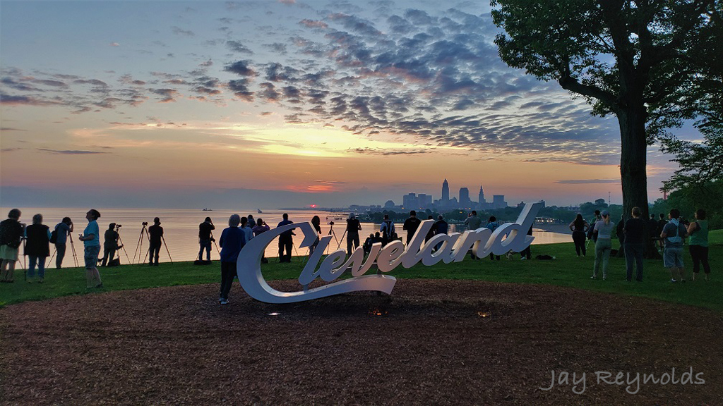 Jay Reynolds -- Early risers viewing sunrise and Cleveland Skyline